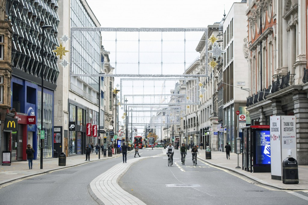 Cyclists ride along a quiet Oxford Street, London, where the majority of shops are closed as England continues a four week national lockdown to curb t...
