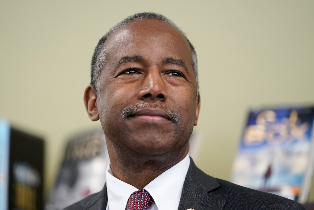 FILE - In this Sept. 22, 2020, file photo Housing and Urban Development Secretary Ben Carson speaks to reporters after touring the Plymouth Place seni...