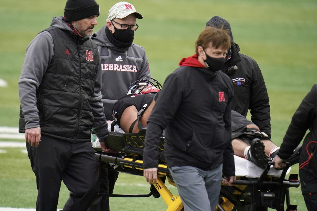 Nebraska linebacker Collin Miller is taken off the field on a stretcher during the second half of an NCAA college football game against Illinois in Li...