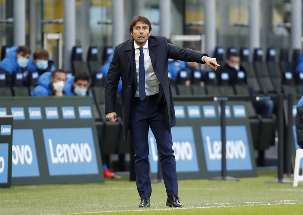 Inter Milan's head coach Antonio Conte gives instructions during the Serie A soccer match between Inter Milan and Torino at the San Siro Stadium, in M...