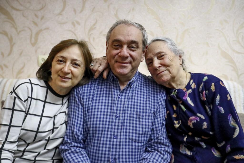 Adil Sharifov poses for a photo with his sister Kamala Sharifova and his mother Adila Ahmadova at home in Baku, Azerbaijan, Friday, Nov. 20, 2020. Adi...