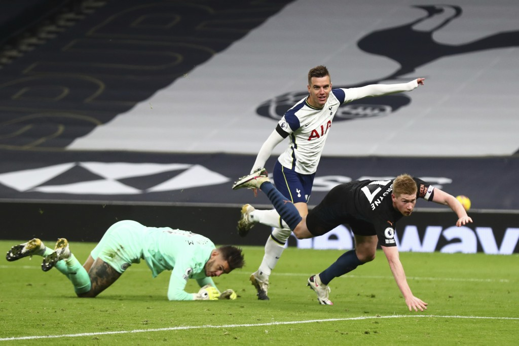 Tottenham's Giovani Lo Celso, center, celebrates after scoring his side's second goal during the English Premier League soccer match between Tottenham...