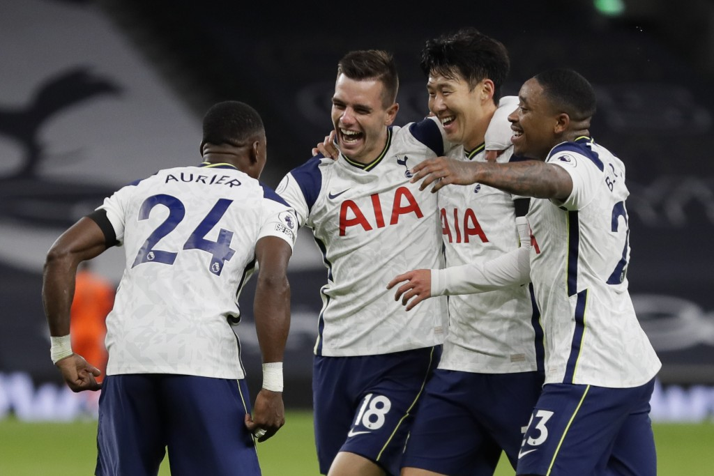 Tottenham's Giovani Lo Celso, second left, celebrates after scoring his side's second goal during the English Premier League soccer match between Tott...