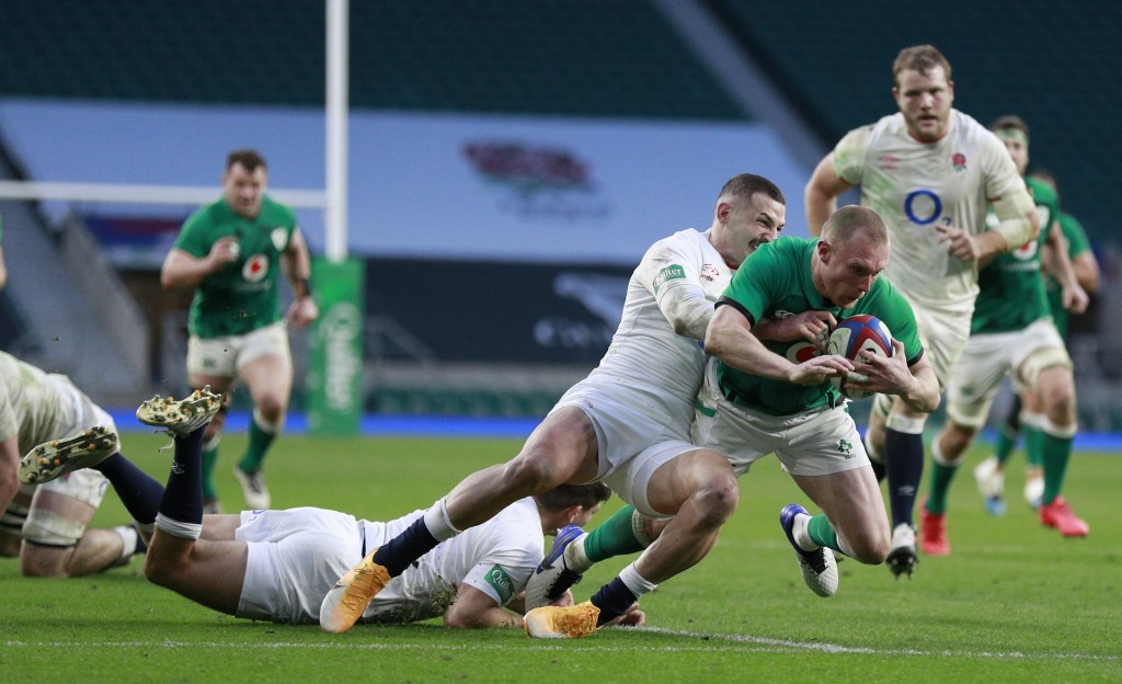 England's Jonny May tackles Ireland's Keith Earls during the Autumn Nations Cup rugby union international match between England and Ireland at Twicken...
