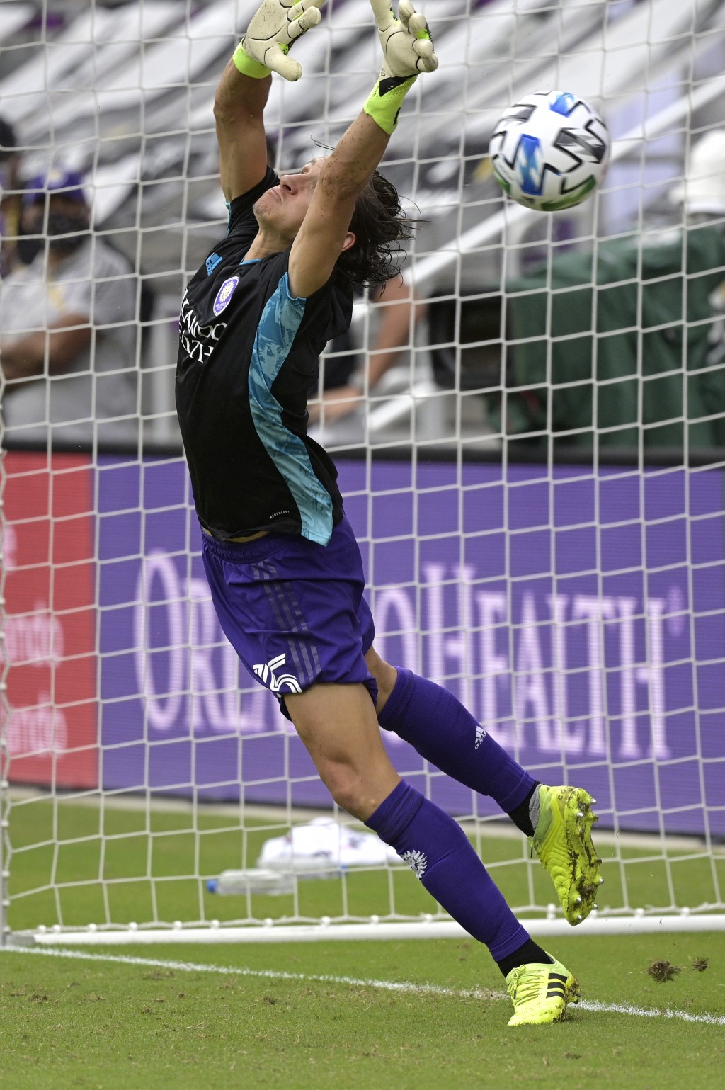 Orlando City defender Rodrigo Schlegel blocks the final New York City FC penalty kick during overtime of an MLS soccer playoff match, Saturday, Nov. 2...
