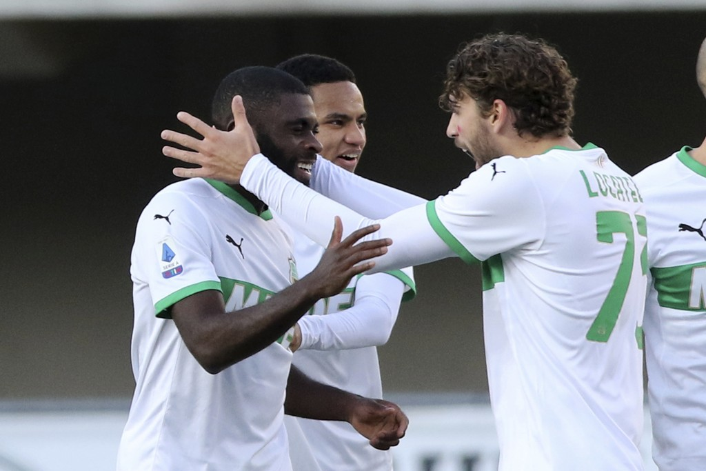 Sassuolo's Jeremie Boga, left, celebrates with Manuel Locatelli after scoring during the Serie A soccer match between Hellas Verona and Sassuolo at th...