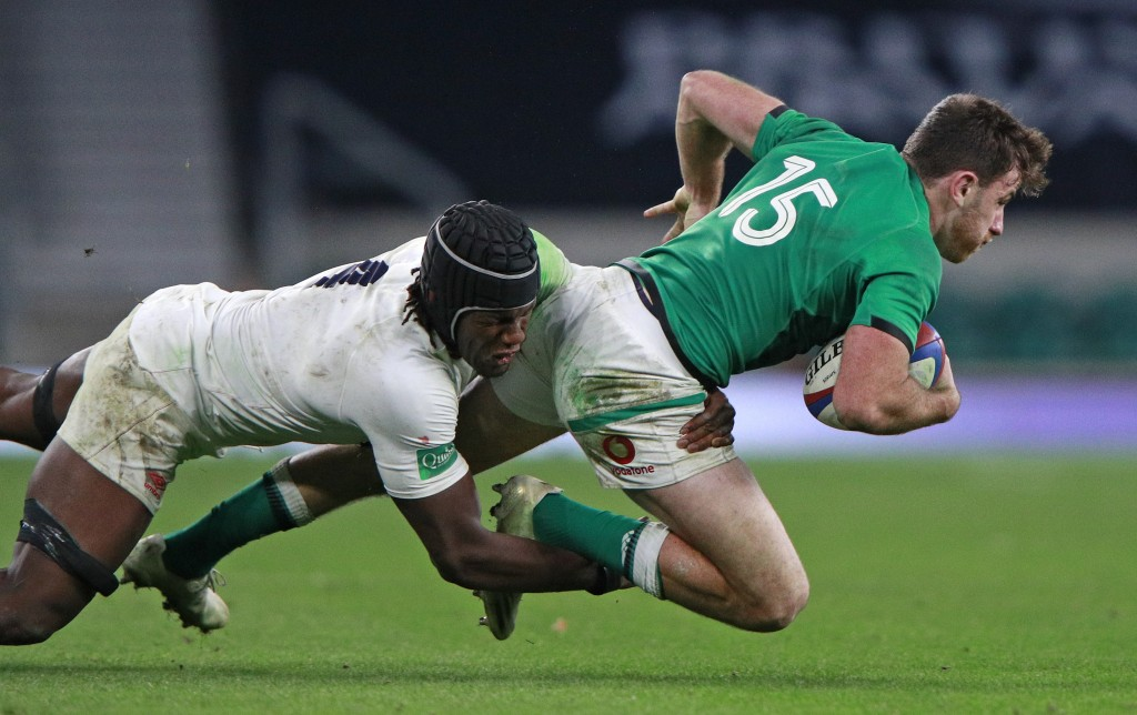 Ireland's Hugo Keenan is tackled by England's Maro Itoje during the Autumn Nations Cup rugby union international match between England and Ireland at ...