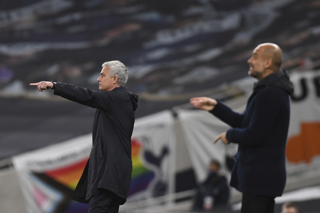 Tottenham's manager Jose Mourinho, left, and Manchester City's head coach Pep Guardiola give instructions from the side line during the English Premie...