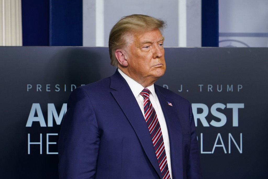 FILE - In this Nov. 20, 2020, file photo President Donald Trump listens during a news conference in the briefing room at the White House in Washington...