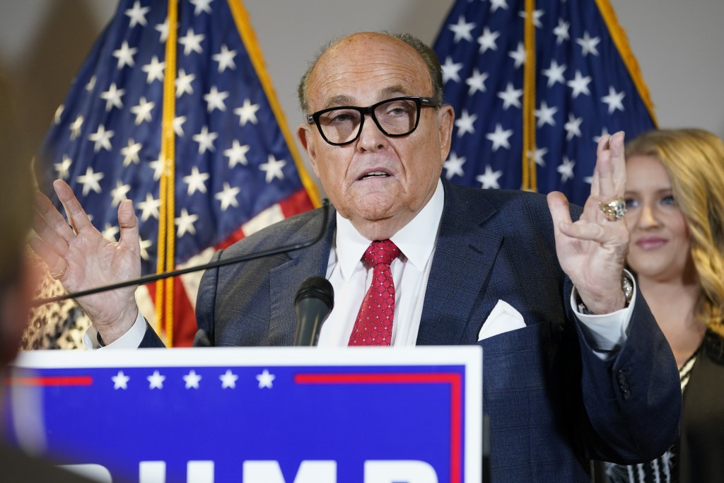 FILE - In this Nov. 19, 2020, file photo former Mayor of New York Rudy Giuliani, a lawyer for President Donald Trump, speaks during a news conference ...
