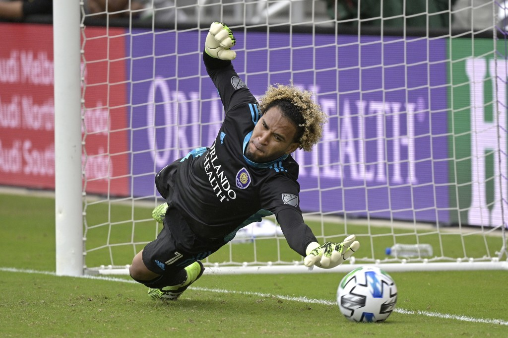 Orlando City goalkeeper Pedro Gallese is unable to make a save on penalty kick New York City FC midfielder Tony Rocha during a shootout in an MLS socc...