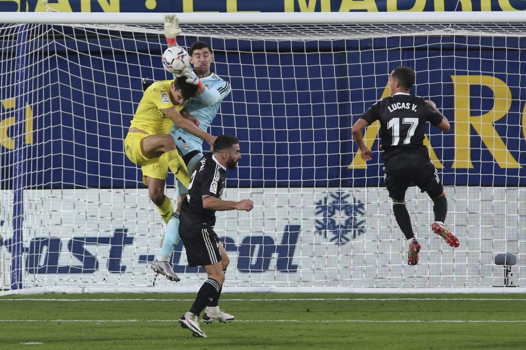 Real Madrid's goalkeeper Thibaut Courtois saves the ball during the Spanish La Liga soccer match between Villarreal and Real Madrid in Ceramica stadiu...