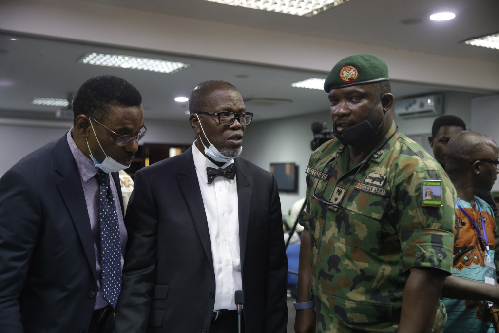 In this photo taken on Saturday Nov. 14, 2020. Brig. Gen. Ahmed Taiwo, Commander of the 81 Military Intelligence Brigade, right, speaks with lawyers b...