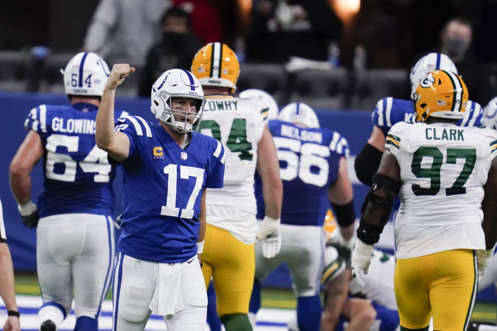 Indianapolis Colts quarterback Philip Rivers (17) celebrates throwing a touchdown pass during the second half of an NFL football game against the Gree...