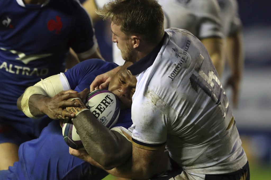 France's Virimi Vakatawa on his way to score a try despite the tackle of Scotland's Stuart Hogg during the Autumn Nations Cup rugby union internationa...