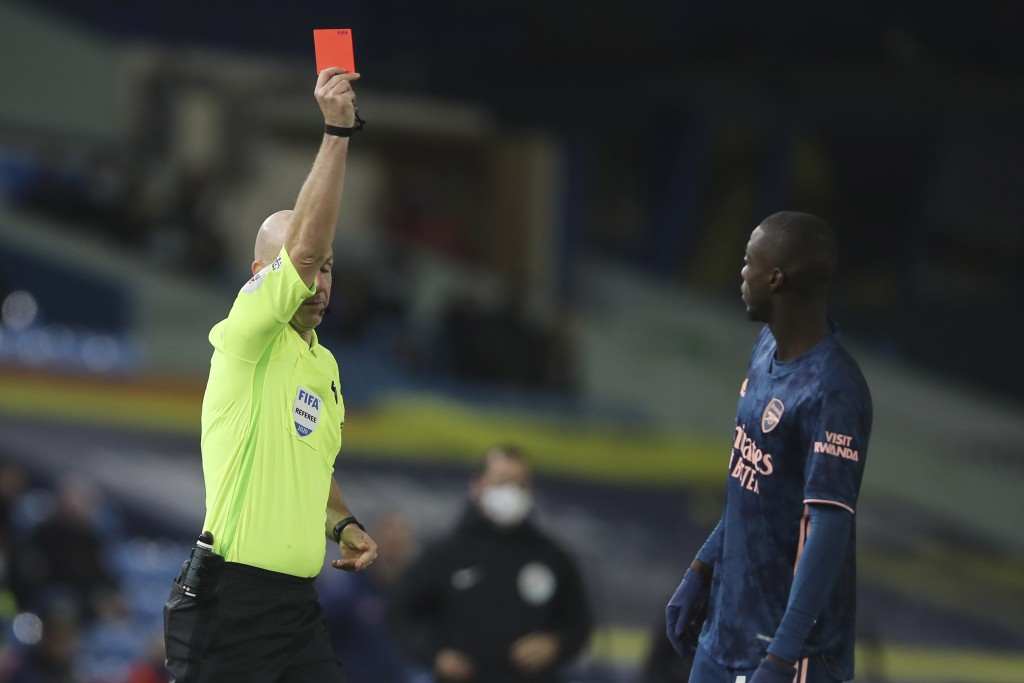 Arsenal's Nicolas Pepe is shown the read card by the referee during an English Premier League soccer match between Leeds United and Arsenal at Elland ...