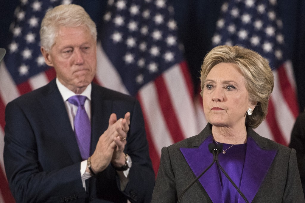 Former President Bill Clinton applauds as his wife, Democratic presidential candidate Hillary Clinton speaks in New York, Wednesday, Nov. 9, 2016, whe...