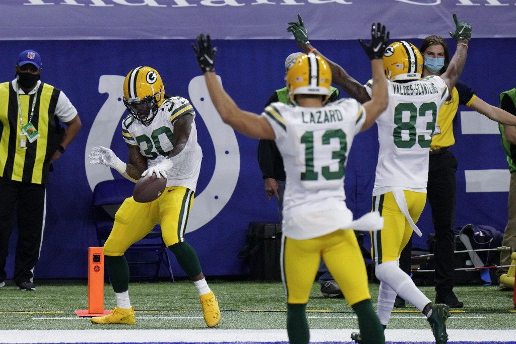 Green Bay Packers' Jamaal Williams (30) celebrates a touchdown during the first half of an NFL football game against the Indianapolis Colts, Sunday, N...