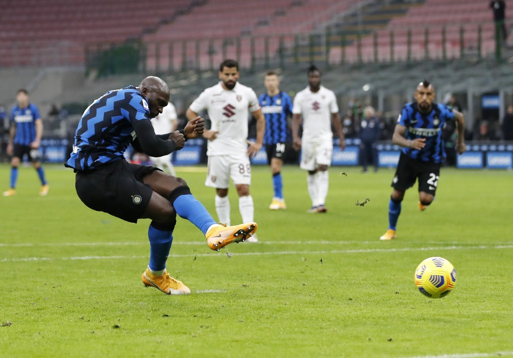 Inter Milan's Romelu Lukaku scores on a penalty kick his side's third goal during the Serie A soccer match between Inter Milan and Torino at the San S...