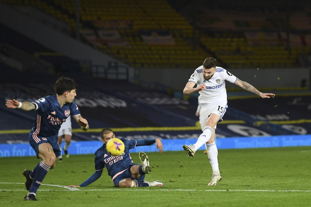 Leeds United's Stuart Dallas shoots on goal during an English Premier League soccer match between Leeds United and Arsenal at Elland Road Stadium in L...