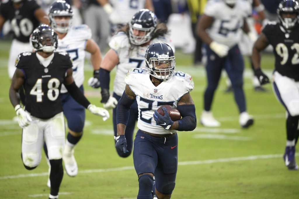 Tennessee Titans running back Derrick Henry (22) runs for a game-winning touchdown against the Baltimore Ravens during overtime of an NFL football gam...