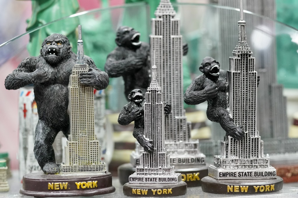 Figurines depicting King Kong on top of the Empire State Building are on display for sale at a gift shop in Lower Manhattan, Tuesday, Nov. 17, 2020. I...
