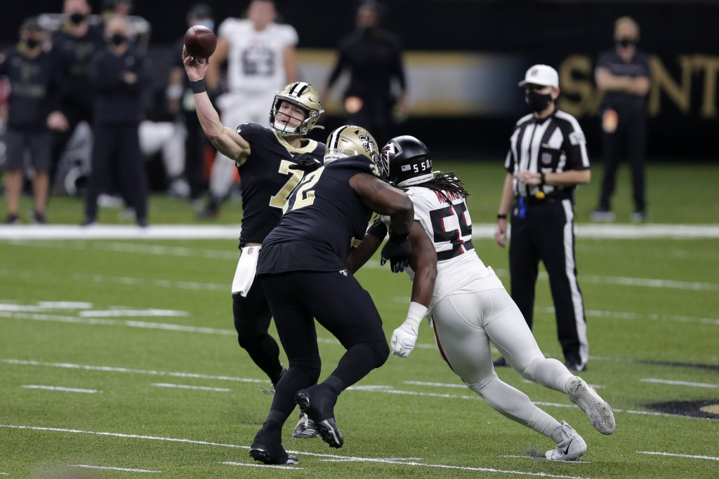New Orleans Saints quarterback Taysom Hill (7) passes under pressure from Atlanta Falcons defensive end Steven Means (55)in the first half of an NFL f...