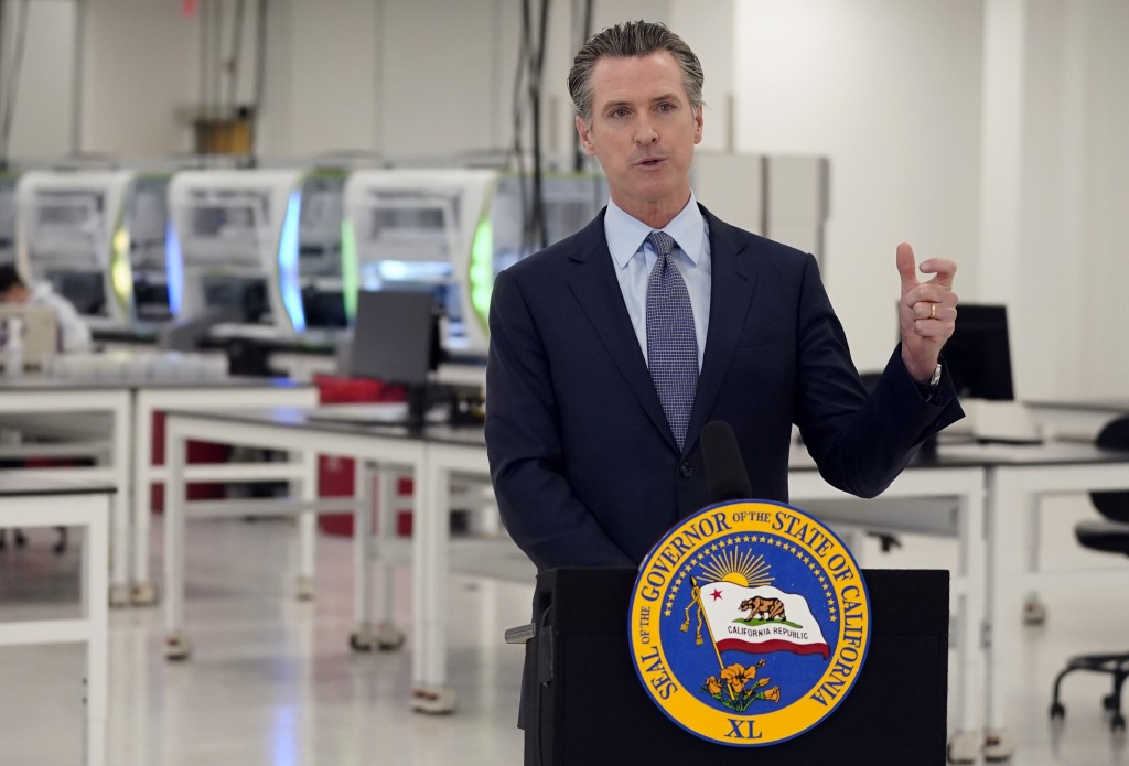 FILE - In this Oct. 30, 2020, file photo, California Gov. Gavin Newsom speaks at a COVID-19 testing facility in Valencia, Calif. Newsom and his family...