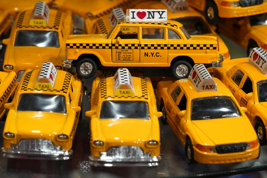 New York Yellow Cab toy cars are on display for sale at a gift shop in Lower Manhattan, Tuesday, Nov. 17, 2020. In souvenir shops from Times Square to...