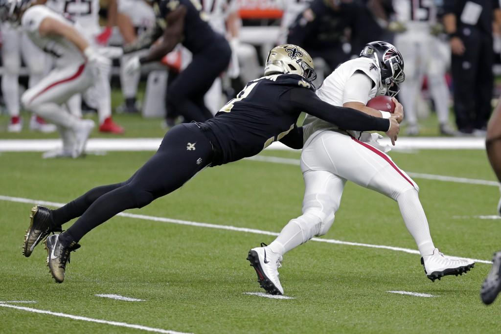 New Orleans Saints defensive end Trey Hendrickson sacks Atlanta Falcons quarterback Matt Ryan in the first half of an NFL football game in New Orleans...