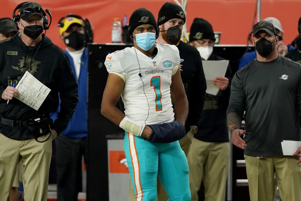 Miami Dolphins quarterback Tua Tagovailoa (1) watches the final minutes from the sidelines during the second half of an NFL football game against the ...