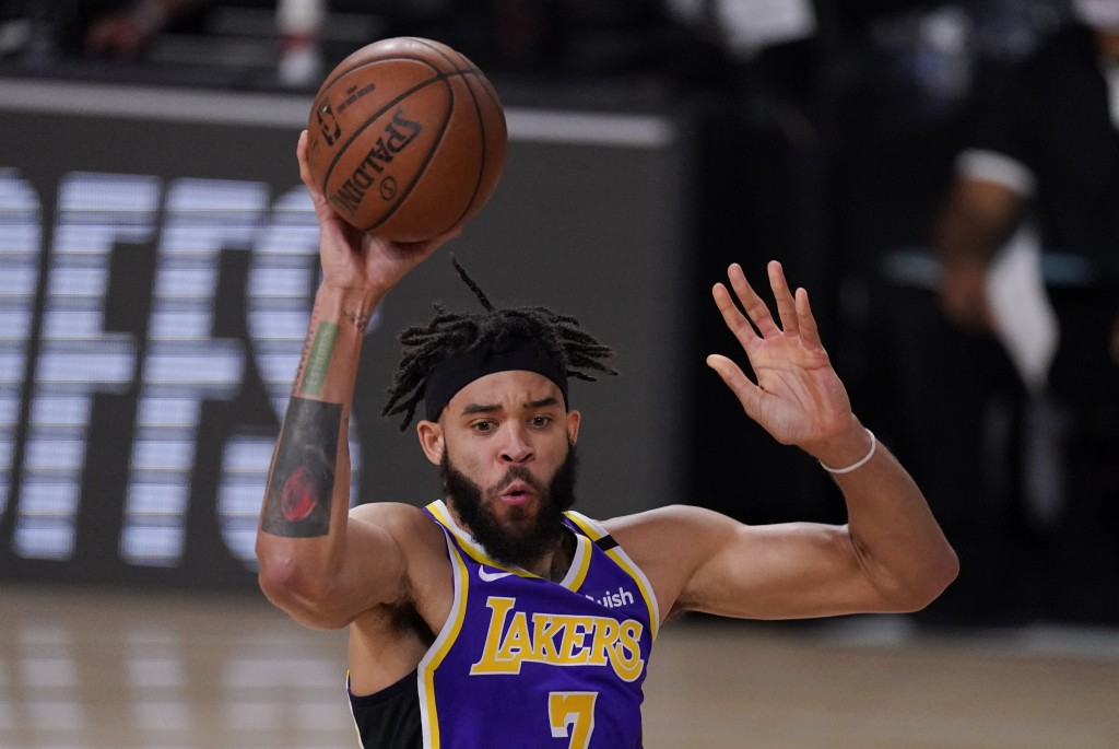 FILE - In this Sept. 4, 2020, file photo, Los Angeles Lakers' JaVale McGee passes the ball during the second half of an NBA conference semifinal playo...