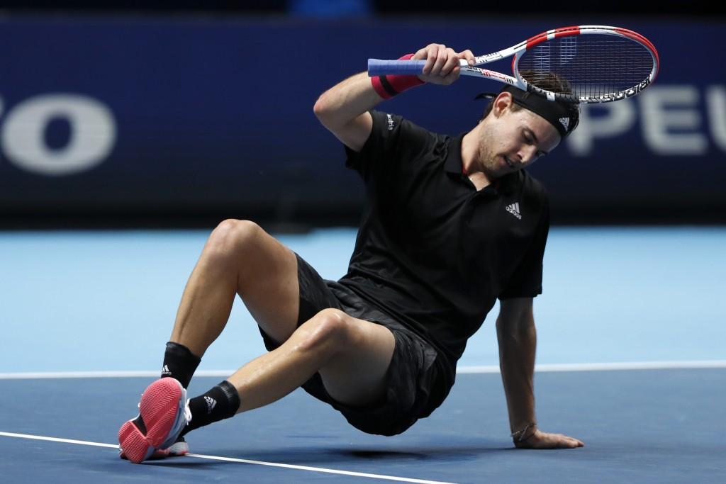 Dominic Thiem of Austria slips over as he plays against Daniil Medvedev of Russia during their singles final tennis match at the ATP World Finals tenn...