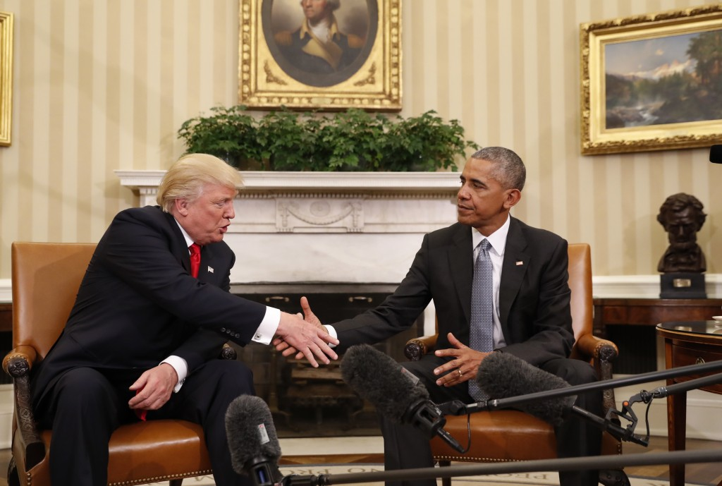 President Barack Obama shakes hands with President-elect Donald Trump in the Oval Office of the White House in Washington, Thursday, Nov. 10, 2016. Pr...