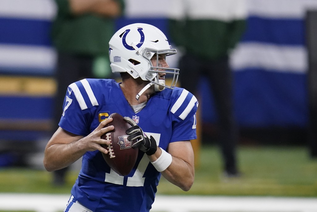 Indianapolis Colts quarterback Philip Rivers (17) looks to throw during the first half of an NFL football game against the Green Bay Packers, Sunday, ...