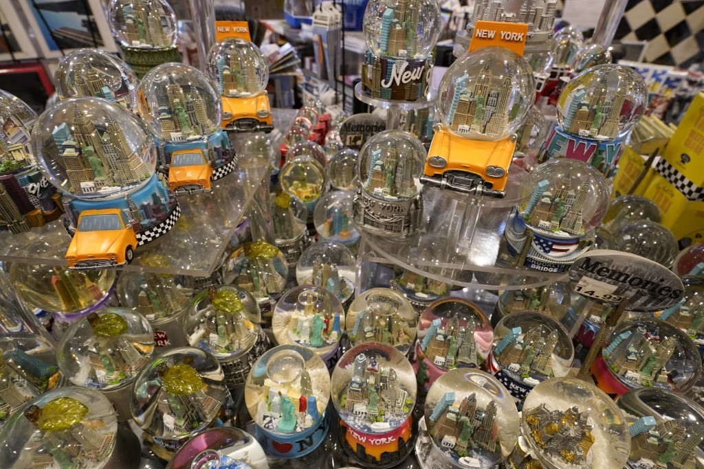Souvenir snow globes featuring New York City themes are on display for sale at Memories of New York gift shop, Thursday, Nov. 12, 2020, in New York. I...