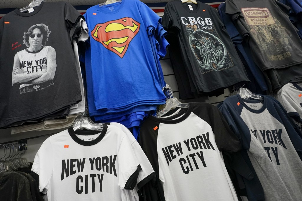 New York City souvenir T-shirts are on display for sale at a gift shop, Thursday, Nov. 12, 2020, in New York's Times Square. In souvenir shops from Ti...