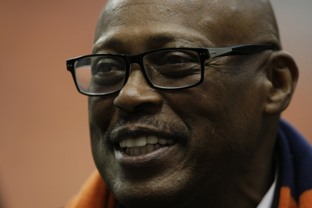FILE - In this Nov. 30, 2013, file photo, NFL great Floyd Little talks to players on the sideline before a Syracuse against Boston College NCAA colleg...