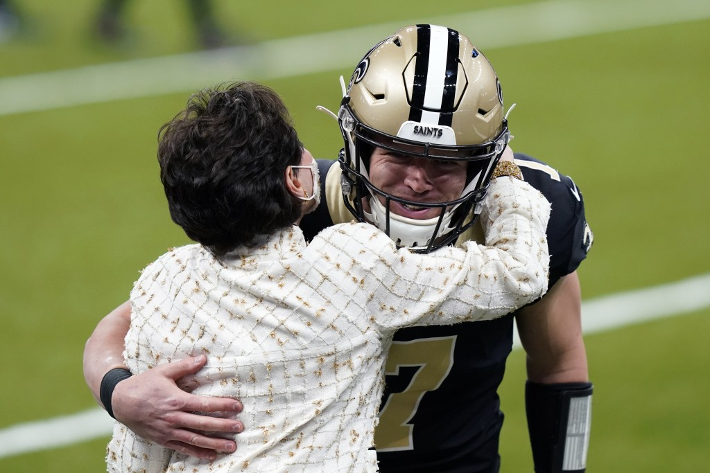 New Orleans Saints quarterback Taysom Hill (7), starting in place of an injured Drew Brees, hugs team owner Gayle Benson before an NFL football game a...