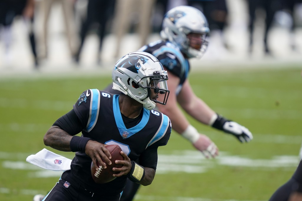 Carolina Panthers quarterback P.J. Walker looks tp pass during the first half of an NFL football game against the Detroit Lions Sunday, Nov. 22, 2020,...
