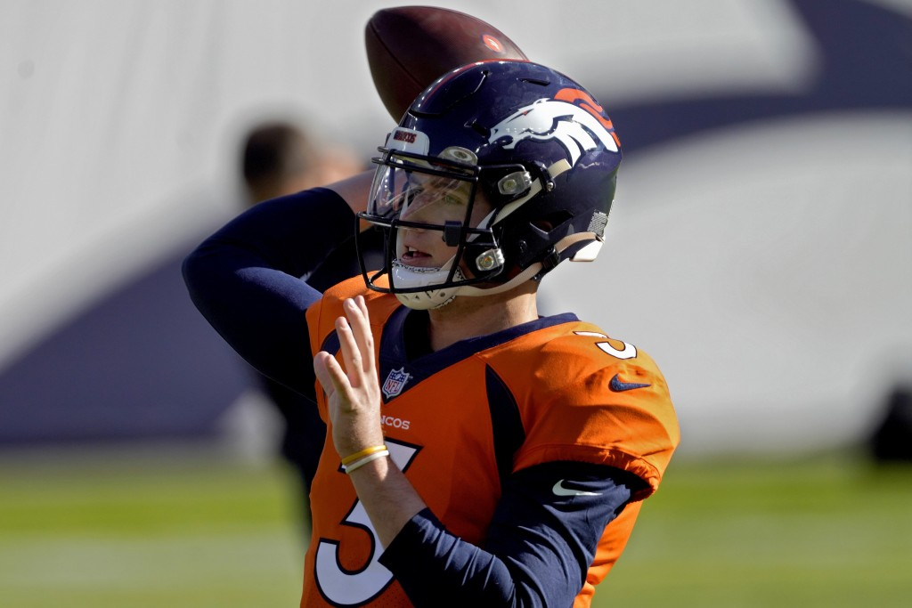 Denver Broncos quarterback Drew Lock (3) warms up prior to an NFL football game against the Miami Dolphins, Sunday, Nov. 22, 2020, in Denver. (AP Phot...