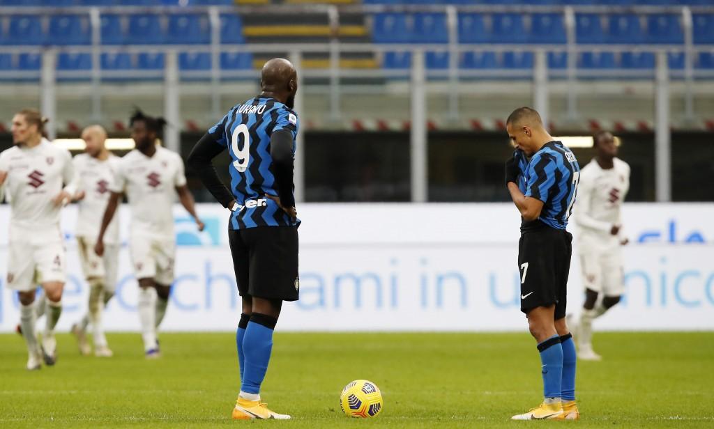 Inter Milan's Romelu Lukaku, left, and Inter Milan's Alexis Sanchez stand after Torino's Cristian Ansaldi scored during the Serie A soccer match betwe...