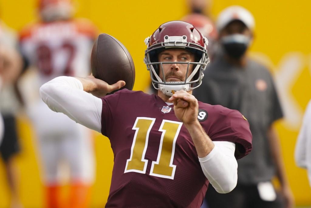 Washington Football Team quarterback Alex Smith (11) throws the ball before the start of an NFL football game against the Cincinnati Bengals, Sunday, ...