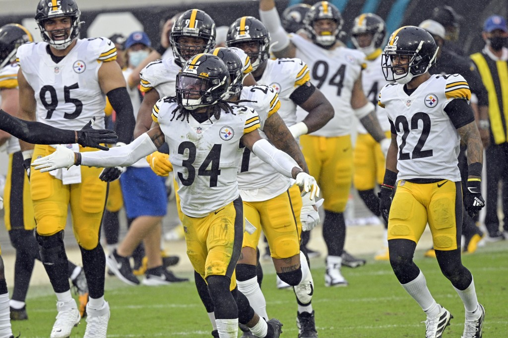 Pittsburgh Steelers safety Terrell Edmunds (34) celebrates with teammates after he intercepted a Jacksonville Jaguars pass during the second half of a...