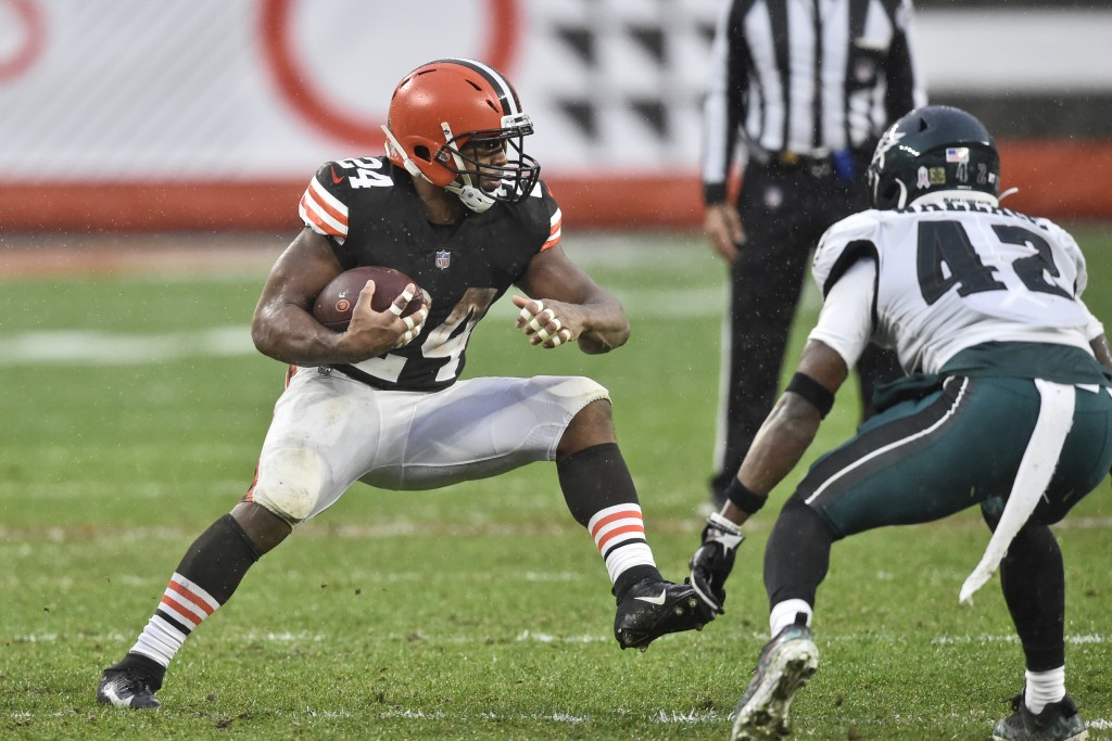 Cleveland Browns running back Nick Chubb (24) rushes against Philadelphia Eagles safety K'Von Wallace (42) during the second half of an NFL football g...