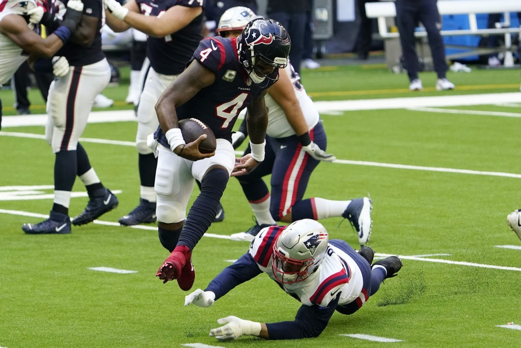 Houston Texans quarterback Deshaun Watson (4) leaps from the grasp of New England Patriots defensive end Tashawn Bower (96) during the first half of a...
