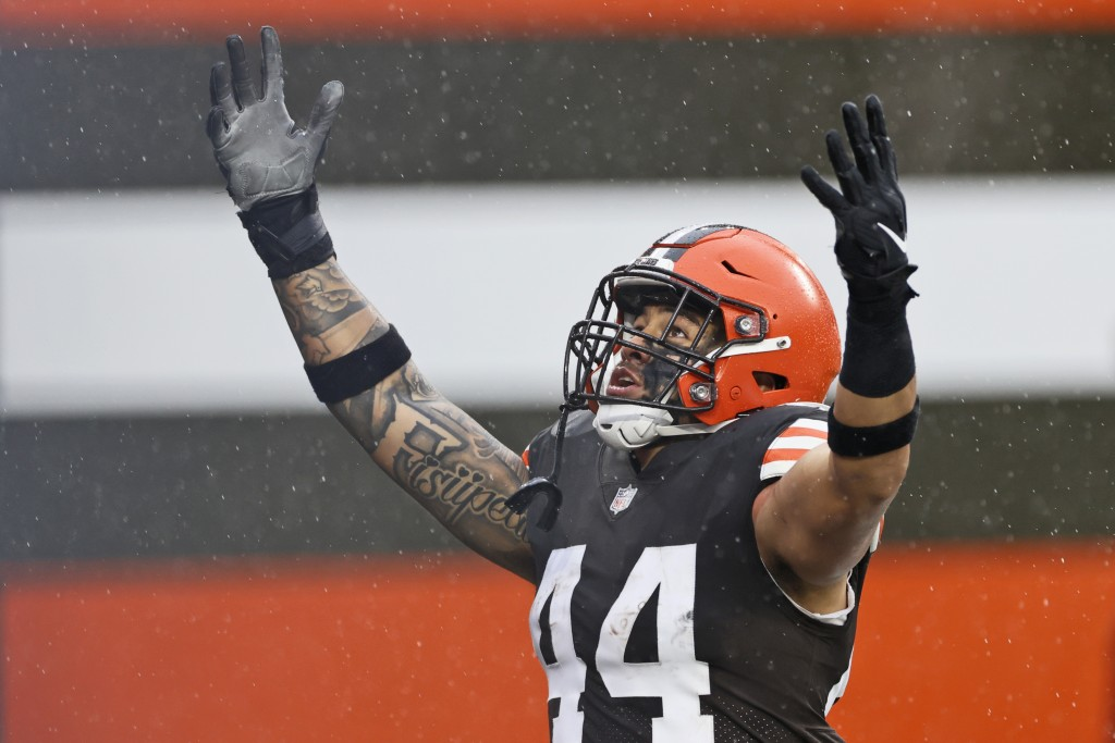Cleveland Browns linebacker Sione Takitaki celebrates after running for a 50-yard interception return touchdown during the first half of an NFL footba...