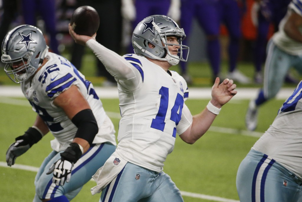 Dallas Cowboys quarterback Andy Dalton throws a pass during the second half of an NFL football game against the Minnesota Vikings, Sunday, Nov. 22, 20...