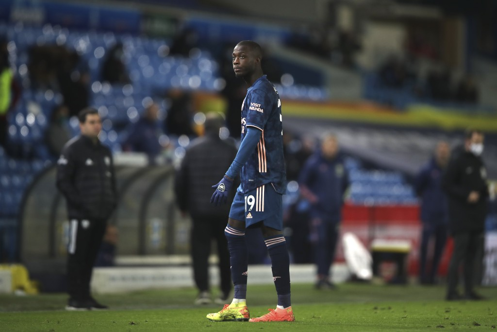 Arsenal's Nicolas Pepe walks off the pitch after being shown the red card by the referee during an English Premier League soccer match between Leeds U...