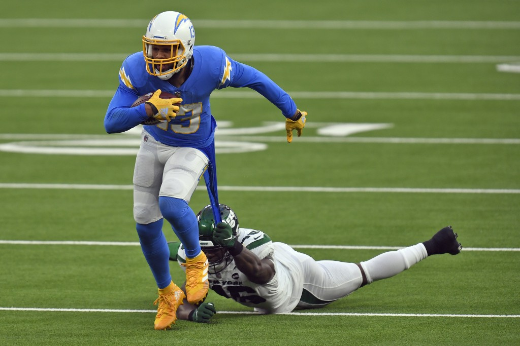 New York Jets linebacker Neville Hewitt, bottom, pulls on the jersey of Los Angeles Chargers wide receiver Keenan Allen after a catch by Allen during ...